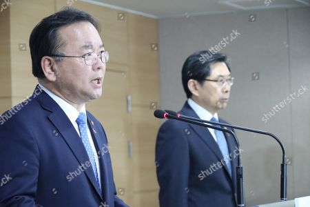Interior Minister Kim Boo-kyum (L) and Justice Minister Park Sang-ki (R) hold a joint press conference in Seoul, South Korea, 19 March 2019. Kim Boo-kyum pledged a full investigation into major cases from the past and present that have raised suspicions of a cover-up and corruption. K-pop celebrities, a former vice justice minister and the head of a major daily are some of the people implicated in sex scandals. President Moon Jae-in ordered a thorough probe on the cases the previous day.