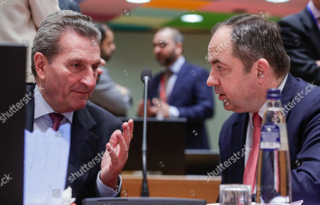 EU Budget Commissioner, German Guenther Oettinger (L) and Konrad Szymanski, Polish European affairs minister at the start of a EU general affairs Council (GAC) at the European Council in Brussels, Belgium, 19 March 2019.