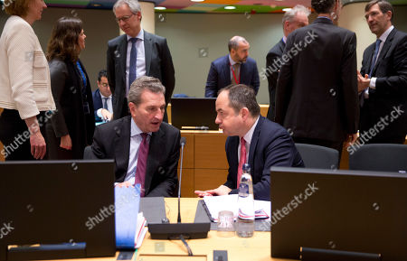 European Commissioner for Budget and Human Resources Guenther Oettinger, left, speaks with Poland's Europe Minister Konrad Szymanski during a meeting of EU ministers for European Affairs at the EU Council building in Brussels, . Germany's European affairs minister Michael Roth says Brexit is not a game and that the EU is worn out by two years of tortuous and interminable negotiations over Britain's departure from the bloc