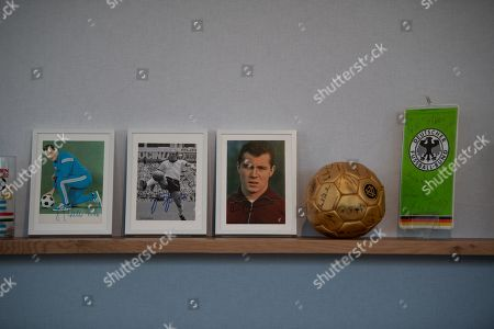 Photographs of former German national soccer team players (L-R) Fritz Walter, Uwe Seeler, and Franz Beckenbauer on display during a press conference in Wolfsburg, Germany, 19 March 2019. Germany will face Serbia in an International Friendly match on 20 March and the Netherlands in an UEFA EURO 2020 qualifier on 24 March 2019.