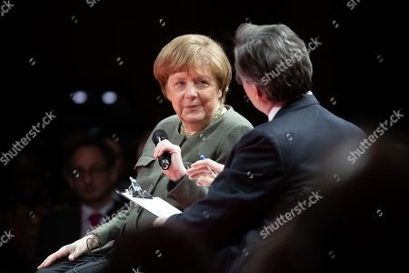 German Chancellor Angela Merkel (L) speaks next to Bloomberg editor-in-chief John Micklethwait (R) during the Global Solutions Summit in Berlin, Germany, 19 March 2019. Representatives from politics, business and society meet in the German capital.
