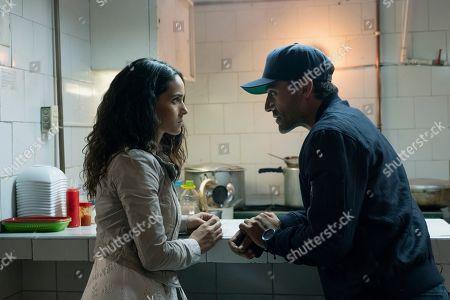 Adria Arjona as Yovanna and Oscar Isaac as Santiago 'Pope' Garcia