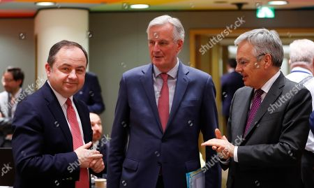 (L-R) Konrad Szymanski, the Polish European affairs minister, Michel Barnier, the European Chief Negotiator of the Task Force for the Preparation and Conduct of the Negotiations with the United Kingdom under Article 50, and Belgium Foreign minister Didier Reynders, chat during the Article 50 EU general affairs council in Brussels, Belgium, in Brussels, Belgium, 19 March 2019.