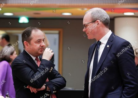 Konrad Szymanski (L), the Polish European affairs ministerand Irish Minister for Foreign Affairs and Trade Simon Coveney (R), chat  during Article 50 EU general affairs council in Brussels, Belgium, 19 March 2019.
