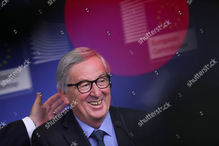 European Commission President Jean-Claude Juncker smiles during a joint press conference with Slovakian President Andrej Kiska at the European Commission headquarters in Brussels, . The British government was preparing Tuesday to ask the European Union for a delay of at least several months to Brexit after the speaker of the House of Commons ruled that Prime Minister Theresa May cannot keep asking lawmakers to vote on the same divorce deal that they have already rejected twice