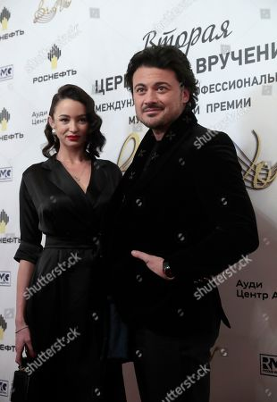 Italian tenor Vittorio Grigolo (R) poses with a guest ahead of the 2nd award ceremony of the International Professional Music Award 'BraVo' in the field of classical arts at the Bolshoi Theatre in Moscow, Russia, 19 March 2019.