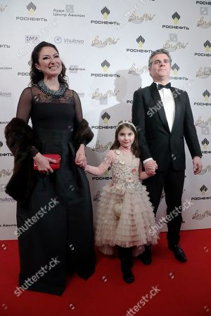 Stock Photo of Spanish soprano Montserrat Marti (L), daugther of late Montserrat Caballe, arrives with businessman Daniel Faidella (R) and their daughter Daniela at the 2nd award ceremony of the International Professional Music Award 'BraVo' in the field of classical arts at the Bolshoi Theatre in Moscow, Russia, 19 March 2019.