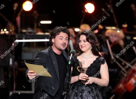 Russian operatic soprano Venera Gimadieva (R) holds her trophy as Italian tenor Vittorio Grigolo speaks during the 2nd award ceremony of the International Professional Music Award 'BraVo' in the field of classical arts at the Bolshoi Theatre in Moscow, Russia, 19 March 2019.