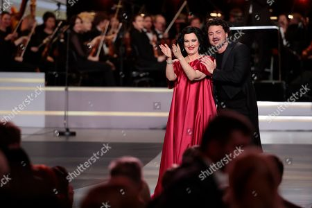 Romanian soprano Angela Gheorghiu (L) and Italian tenor Vittorio Grigolo (R) react during the 2nd award ceremony of the International Professional Music Award 'BraVo' in the field of classical arts at the Bolshoi Theatre in Moscow, Russia, 19 March 2019.