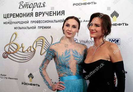 Stock Photo of Bolshoi Theatre prima ballerina Svetlana Zakharova (L) and Russian singer, patroness of the Federation charity foundation Yelena Sever (R) pose ahead of the 2nd award ceremony of the International Professional Music Award 'BraVo' in the field of classical arts at the Bolshoi Theatre in Moscow, Russia, 19 March 2019.