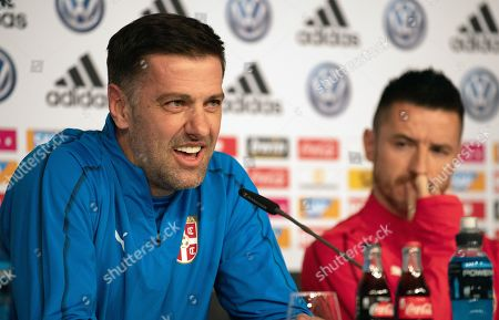 Serbian national soccer team head coach Mladen Krstajic (L) and player Antonio Rukavina attend a press conference in Wolfsburg, Germany, 19 March 2019. Serbia will face Germany in an International Friendly match on 20 March 2019.