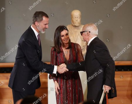 Stock Photo of Spain's King Felipe VI (L) and Queen Letizia (C) award Spanish graphic designer and humorist Alfredo Gonzalez (R) during the National Culture Awards ceremony held at the Prado Museum in Madrid, Spain, 19 March 2019. The awards, which were selected in 2017, will be delivered to the Spanish writers Rosa Montero and Fernando Aramburu, journalist Matias Prats, fashion designer Agatha Ruiz de la Prada and bullfighter Enrique Ponce.