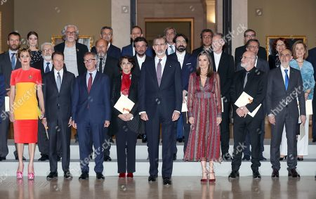 Stock Image of Spain's King Felipe VI (C) and Queen Letizia (C-R) pose with awarded people and other attendants at the National Culture Awards ceremony held at the Prado Museum in Madrid, Spain, 19 March 2019. The awards, which were selected in 2017, will be delivered to the Spanish writers Rosa Montero and Fernando Aramburu, journalist Matias Prats, fashion designer Agatha Ruiz de la Prada and bullfighter Enrique Ponce.