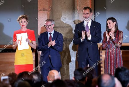 Stock Picture of Spanish Culture and Sports Minister, Jose Guirao (2-L), Spain's King Felipe VI (2-R) and Queen Letizia (R) applaud to Spanish designer Agatha Ruiz de la Prada (L) attend the National Culture Awards ceremony held at the Prado Museum in Madrid, Spain, 19 March 2019. The awards, which were selected in 2017, will be delivered to the Spanish writers Rosa Montero and Fernando Aramburu, journalist Matias Prats, fashion designer Agatha Ruiz de la Prada and bullfighter Enrique Ponce.