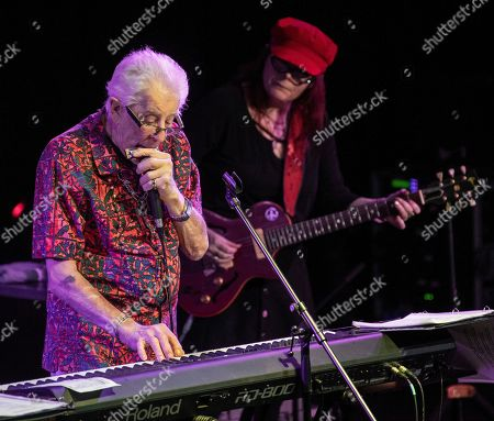 Stock Photo of British blues musician John Mayall (L) performs on stage as part of his ' John Mayall 85th Anniversary Tour' in Akvarium Klub in Budapest
