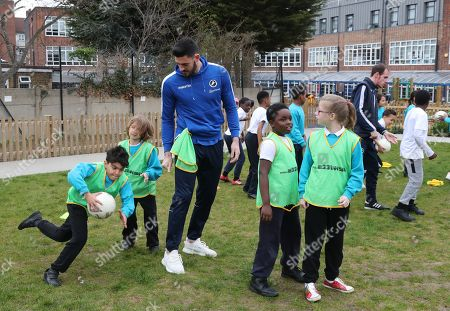 Millwall Goalkeeper Tom King  goes through a few drills with the children