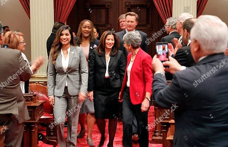 In this photo provided by the Judicial Council of California, legislators applaud as California Chief Justice Tani Cantil-Sakauye arrives to deliver her State of the Judiciary address before a joint session of the Legislature at the Capitol in Sacramento, Calif., . California's chief justice is praising the racial and gender diversity of judges appointed to the state courts by former Gov. Jerry Brown. Tani Cantil-Sakauye said during her annual address to California lawmakers that Brown had breathed new life into the courts