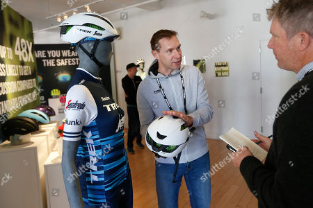 Stock Picture of Former pro-cyclist Jens Voigt, who rode for the Trek-Segafredo men's team, shares an up-close look at the groundbreaking new WaveCel helmet technology at an event in New York. WaveCel is a collapsible cellular structure that lines the inside of your helmet and works like a crumple zone that absorbs the force of an impact before it reaches your head