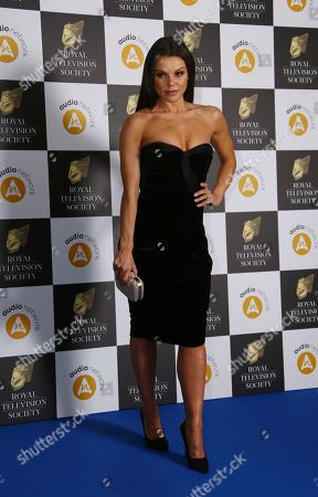 Faye Brooks poses for photographers upon arrival for a the Royal Television Society Awards in central London
