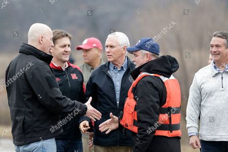 Mike Pence, Pete Ricketts, Ben Sasse, Don Bacon, Brad Brown. Vice President Mike Pence, center, is accompanied by Neb. Gov. Pete Ricketts, left, Sen. Ben Sasse, R-Neb., second left, and Rep. Don Bacon, R-Neb., right, as he meets with volunteers and first responders, including Brad Brown, second right, who had helped victims of the recent flooding, in Omaha, Neb., to view the recent floods and offer support for it's victims