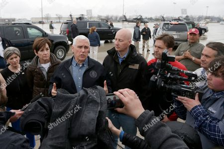 Stock Picture of Mike Pence, Joni Ernst, Kim Reynolds, Pete Ricketts, Ben Sasse, Don Bacon. Vice President Mike Pence, center speaks to reporters upon arriving to Omaha, Neb., to view the extent of recent flooding and to offer support, with Sen. Joni Ernst, R-Iowa, left, Iowa Gov. Kim Reynolds, second left, Neb. Gov. Pete Ricketts, third right, Sen. Ben Sasse, R-Neb., second right, and Rep. Don Bacon, R-Neb., right