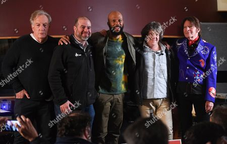 Stock Photo of Alan Zweibel, Andy Bernstein, Common, Michael Lang, John Fogerty. Comedy writer Alan Zweibel, left, HeadCount executive director Andy Bernstein, Hip hop recording artist Common, left, Woodstock co-producer and co-founder, Michael Lang and musician John Fogerty participate in the Woodstock 50 lineup announcement at Electric Lady Studios, in New York