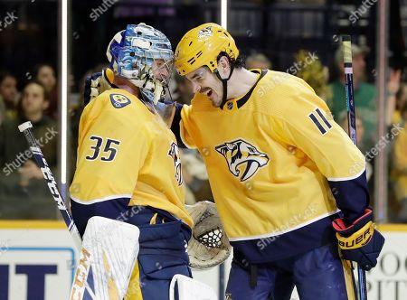 Nashville Predators center Brian Boyle (11) congratulates goaltender Pekka Rinne (35), of Finland, after Rinne shut out the Toronto Maple Leafs 3-0 in an NHL hockey game, in Nashville, Tenn