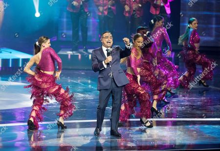 Stock Picture of Puerto Rican salsa singer Gilberto Santa Rosa performs on stage during the Soberano Awards ceremony in Santo Domingo, Dominican Republic, 19 March 2019. The Soberano Awards, organized by the Association of Art Writers (Acroarte), recognize the work of representatives of the world of art and culture.