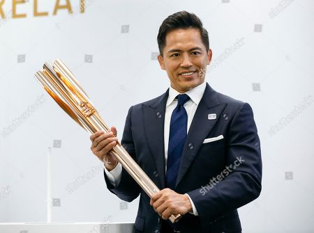 Tadahiro Nomura (R), three-time Olympic judo champion, shows the Tokyo 2020 Olympic Torch during an unveiling ceremony in Tokyo, Japan, 20 March 2019, one year before the arrival of the Olympic Flame in Japan. The Olympic Torch Relay will start on 26 March 2020 and will travese a large portion of Japan for 121 days until 24 July 2020.