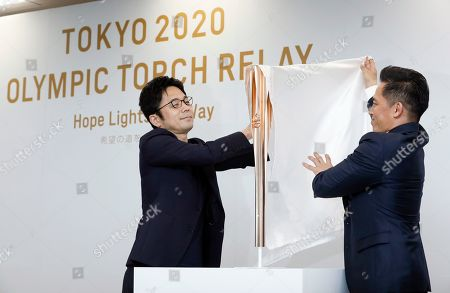 Tadahiro Nomura (R), three-time Olympic judo champion, and Tokujin Yoshioka (L), chief Tokyo 2020 Torch designer, unveil the Tokyo 2020 Olympic Torch during an unveiling ceremony in Tokyo, Japan, 20 March 2019, one year before the arrival of the Olympic Flame in Japan. The Olympic Torch Relay will start on 26 March 2020 and will travese a large portion of Japan for 121 days until 24 July 2020.
