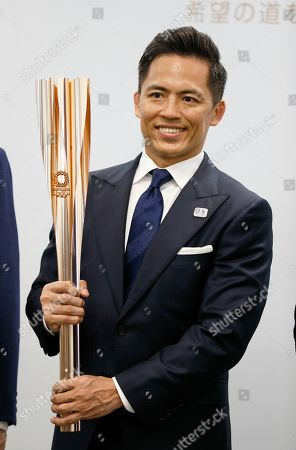 Tadahiro Nomura, three-time Olympic judo champion, holds the Tokyo 2020 Olympic Torch during an unveiling ceremony in Tokyo, Japan, 20 March 2019, one year before the arrival of the Olympic Flame in Japan. The Olympic Torch Relay will start on 26 March 2020 and will travese a large portion of Japan for 121 days until 24 July 2020.