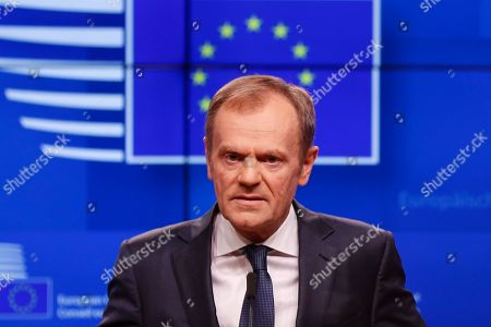 European Council President Donald Tusk speaks during a media conference on Brexit at the Europa building in Brussels, . EU chief Donald Tusk conditions Brexit extension on UK Parliament backing government's Brexit deal and insists the legal agreement negotiated by EU and U.K. government won't be reopened
