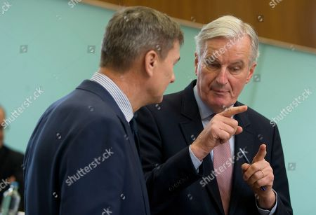 Stock Picture of European Union chief Brexit negotiator Michel Barnier, right, speaks with European Commissioner for Digital Single Market Andrus Ansip during a meeting of the college of commissioners at EU headquarters in Brussels