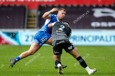 Ross Moriarty of the Dragons tackles Scott Baldwin of the Ospreys
