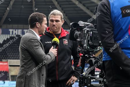 Richard Hibbard of the Dragons gets interviewed before the match