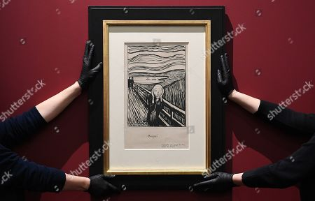 British Museum staff pose with 'Scream' lithograph print by Norwegian painter Edvard Munch at the British Museum in London, Britain, 20 March 2019. The British Museum is to present a major new exhibition of the work of the Edvard Munch. 'Love and Angst' will look at Munch's experimental prints.