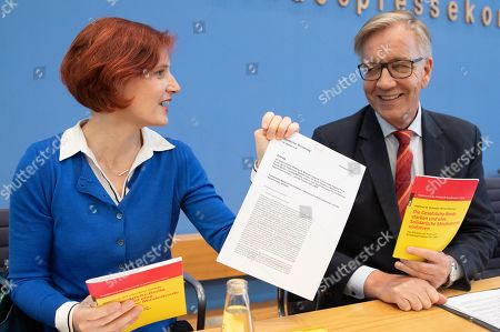 The Left (Die Linke) co-chairwoman Katja Kipping (L) presents the proposal paper 'effectively preventing and combating old-age poverty - raising the level of pensions and introducing the minimum pension' next to the Left faction in the German parliament Bundestag co-chairman Dietmar Bartsch (R) holding the book 'Strengthen the statutory pension and introduce a solidarity minimum pension' during a presser in Berlin, Germany, 20 March 2019. The Left party leaders introduce a new proposal to solve old-age poverty.