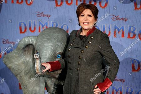 Liane Foly poses during a photocall for the premiere of 'Dumbo' in Paris