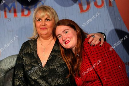 Valerie Damidot and Roxanne Damidot pose during a photocall for the premiere of 'Dumbo' in Paris