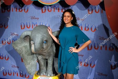 Stock Photo of Cerise Calixte poses during a photocall for the premiere of 'Dumbo' in Paris