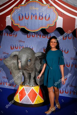 Stock Picture of Cerise Calixte poses during a photocall for the premiere of 'Dumbo' in Paris