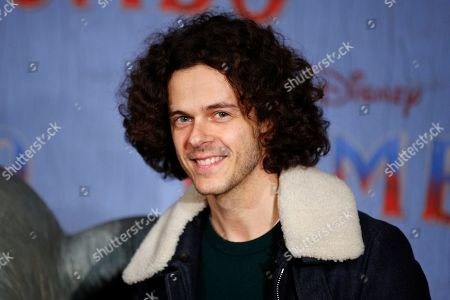 Michael Gregorio poses during a photocall for the premiere of 'Dumbo' in Paris