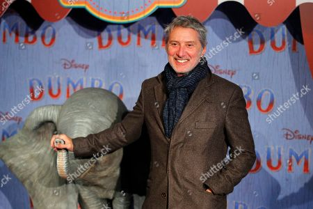 Antoine De Caunes poses during a photocall for the premiere of 'Dumbo' in Paris