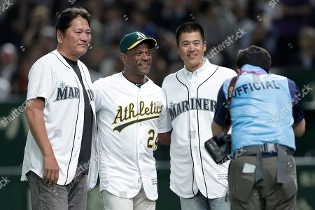 Stock Image of Former Oakland Athletics and Baseball Hall of Fame player Rickey Henderson (2-L) poses with former Seattle Mariners players Kazuhiro Sasaki (L) and Kenji Jojima (2-R) after the ceremonial first pitch prior to the start of the the first game between the Oakland Athletics and the Seattle Mariners during the Major League Baseball (MLB) Opening Games at Tokyo Dome in Tokyo, Japan, 20 March 2019.