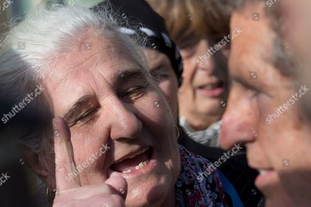 Munira Subasic of the Mothers of Srebrenica, left, haggles Peter Robinson of the U.S., lawyer for former Bosnian Serb leader Radovan Karadzic, after the court upheld Karadzic's conviction at International Residual Mechanism for Criminal Tribunals in The Hague, Netherlands, . Nearly a quarter of a century since Bosnia's devastating war ended, Karadzic heard the final judgment upholding 2016 convictions for genocide, crimes against humanity and war crimes, and an increase from his 40-year sentence to life