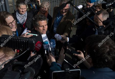 Peter Robinson of the U.S., lawyer for former Bosnian Serb leader Radovan Karadzic, gives a statement after the court upheld Karadzic's conviction at International Residual Mechanism for Criminal Tribunals in The Hague, Netherlands, . Nearly a quarter of a century since Bosnia's devastating war ended, Karadzic heard the final judgment upholding 2016 convictions for genocide, crimes against humanity and war crimes, and an increase from his 40-year sentence to life