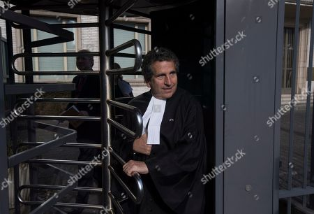 Peter Robinson of the U.S., lawyer for former Bosnian Serb leader Radovan Karadzic,leaves the court building to give a statement after the court upheld Karadzic's conviction at International Residual Mechanism for Criminal Tribunals in The Hague, Netherlands, . Nearly a quarter of a century since Bosnia's devastating war ended, Karadzic heard the final judgment upholding 2016 convictions for genocide, crimes against humanity and war crimes, and an increase from his 40-year sentence to life