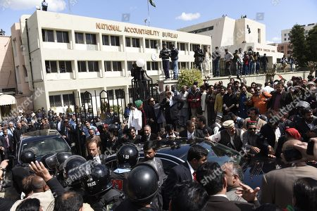 People surround vehicles carrying Bilawal Bhutto Zardari, chairman of opposition party Pakistan People Party and his father former President Asif Zardari as they leave after appearing before the National Accountability Bureau (NAB) in Islamabad, Pakistan, 20 March 2019. Bilawal Bhutto Zardari and his father former President Asif Zardari appeared before NAB on 20 March to record their statements in the Park Lane Estate corruption case.