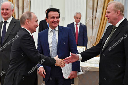 Stock Picture of Russian President Vladimir Putin (L)  shakes hands with British Petroleum (BP) Group Chief Executive Bob Dudley (R) next to Pascal Soriot, executive director and CEO of AstraZeneca (C), during a meeting with British businessmen at the Kremlin in Moscow, Russia, 20 March 2019.