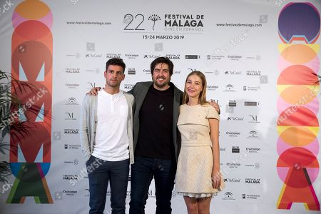 Spanish film director Roberto Bueso (C) and cast members Gonzalo Fernandez (L) and Charlotte Vega pose for the photographers during the presentation of the film 'La Banda' (The Band) as part of 22th Malaga Film Festival, in Malaga, southern Spain, 20 March 2019. The film competes in the official section of the festival running from 15 March to 24 March.